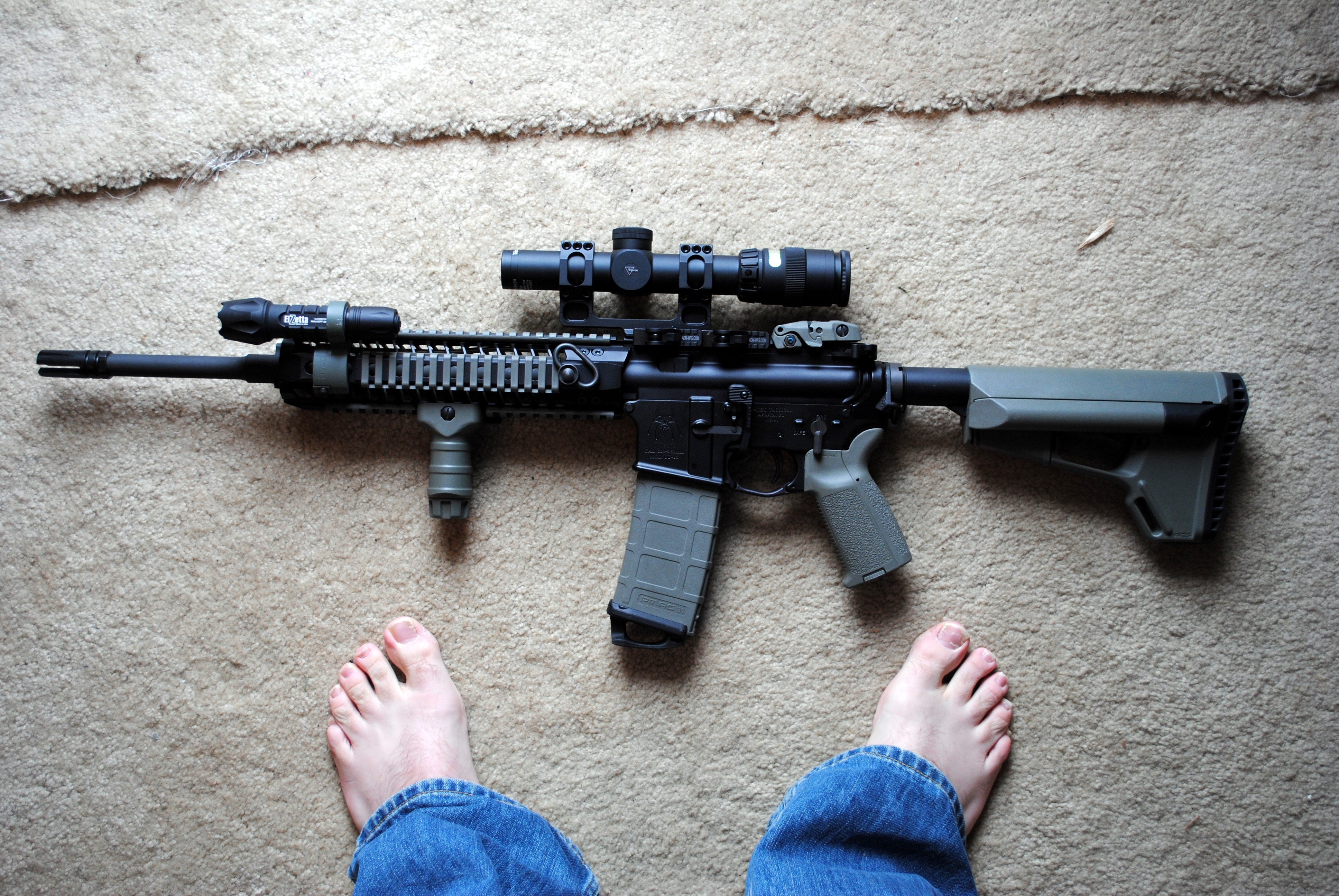 My first AR-15 project, built to make the internet proud (right down to the feet-in-the-frame picture)