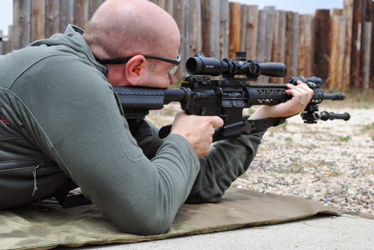 The Marksman shooting an AR-15 equipped with a longer range scope. This prevents shooting NTCH.
