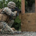 A USMC competitor in the 4th Marine Division Annual Rifle Squad Competition, conducts an Unknown Distance course of fire from the kneeling position