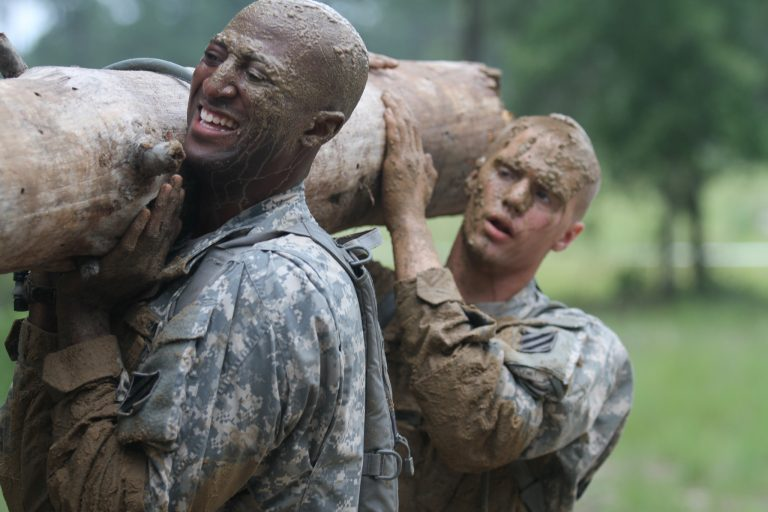 US Army Calvary troopers exhibiting tactical fitness with a log carry