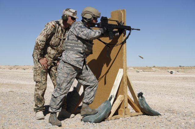 A German instructor coaching the supported standing position with a G-36. Army Photo by Abigail Meyer Fort Bliss Bugle Staff