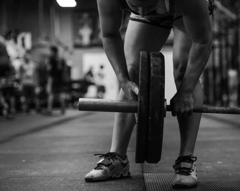 Active duty USAF Airman building tactical fitness through weight lifting