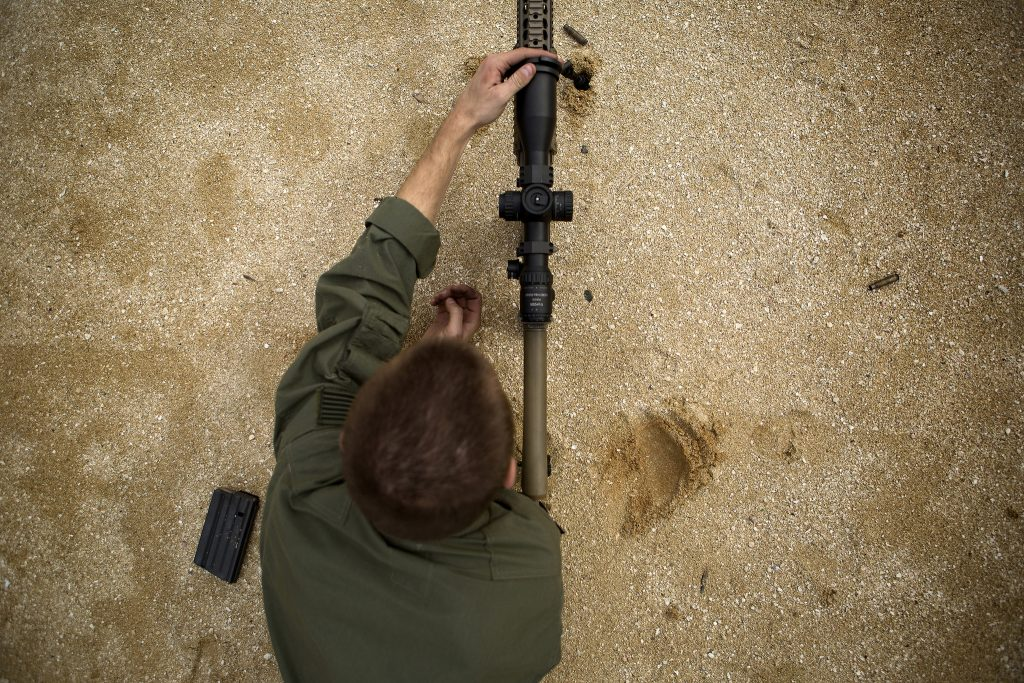USMC shooter on a sniper weapon system, using either minutes of angle or milliradian optics