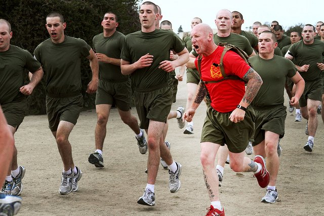 Drill instructors of Company C, 1st Recruit Trianing Battalion, encourage recruits to exert maximum effort to excel during the quarter-mile sprint exercise aboard Marine Corps Recruit Depot San Diego April 16.