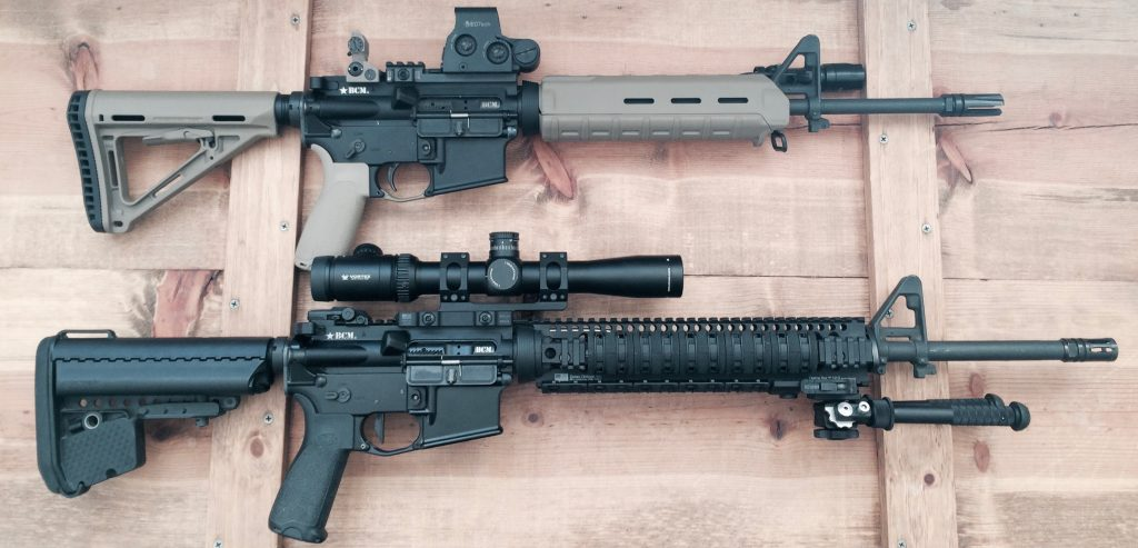 A lightweight AR-15 next to a heavier variant